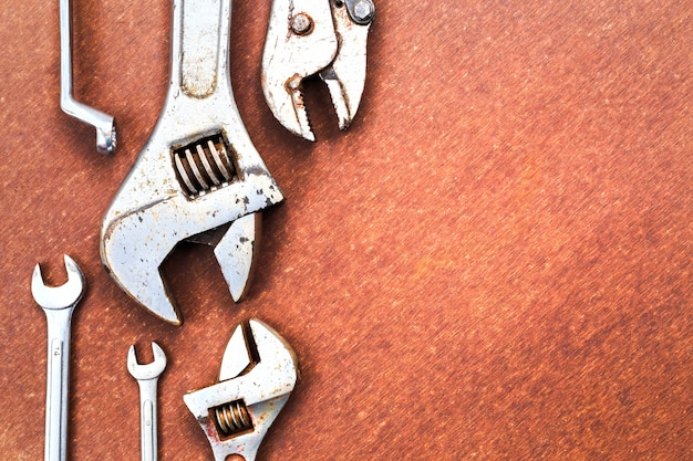 Working tools on wooden table background. top view Premium Photo