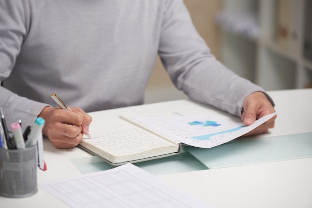 Working with financial report Free Photo