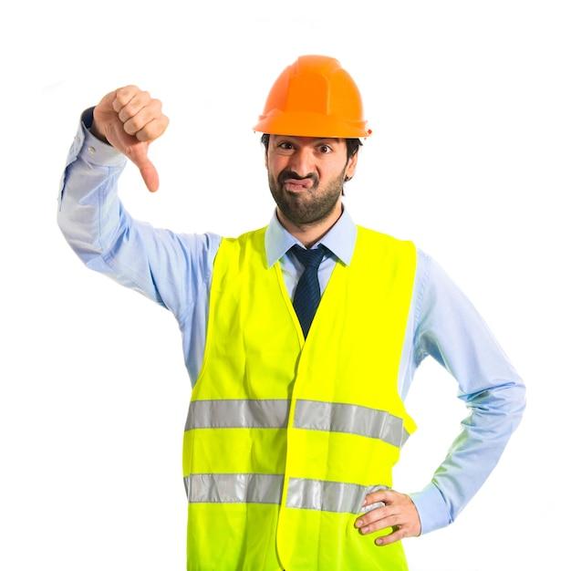 Workman doing a bad signal Free Photo