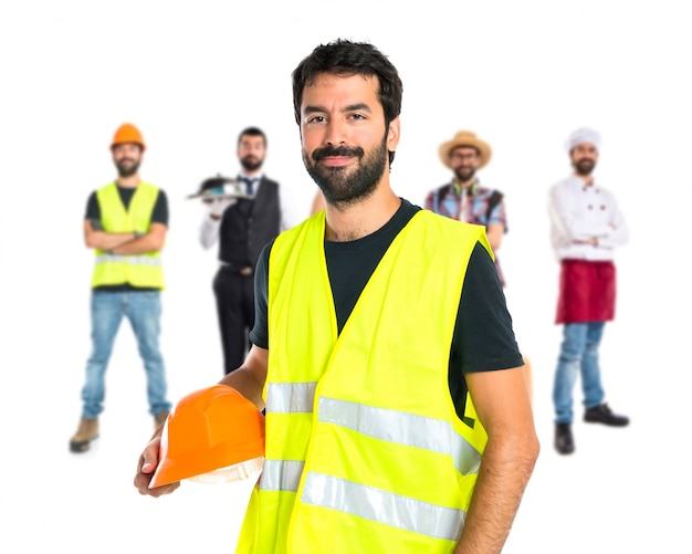 Workman over white background Free Photo