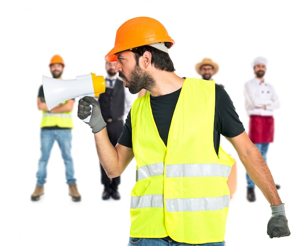 Workman shouting over isolated white background Free Photo