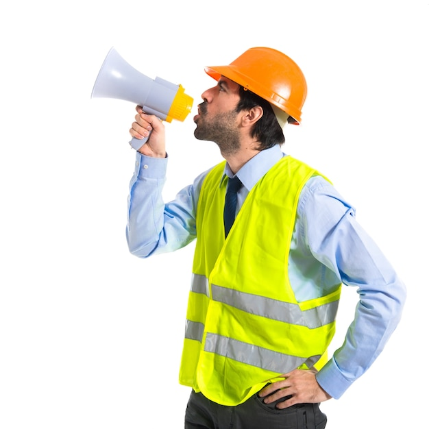 workman shouting over white background Free Photo