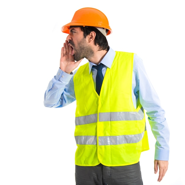 Workman shouting over white background Free Photo