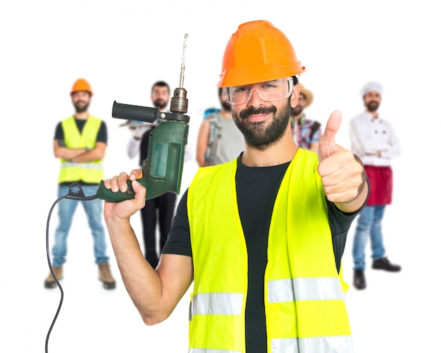 workman with drill over white background Free Photo