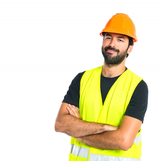 Workman with his arms crossed over white background Free Photo