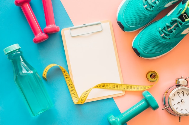 Workout composition with clipboard and fitness tools Free Photo