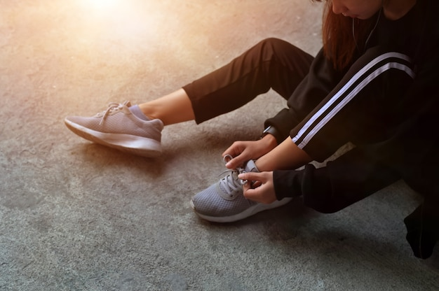 Workout diet concept, runner trying running shoes get ready for run. Premium Photo
