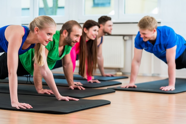 Workout group in gymnasium during physiotherapy Premium Photo