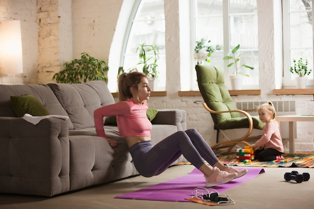 Workout with sofa. young woman working out at home Free Photo