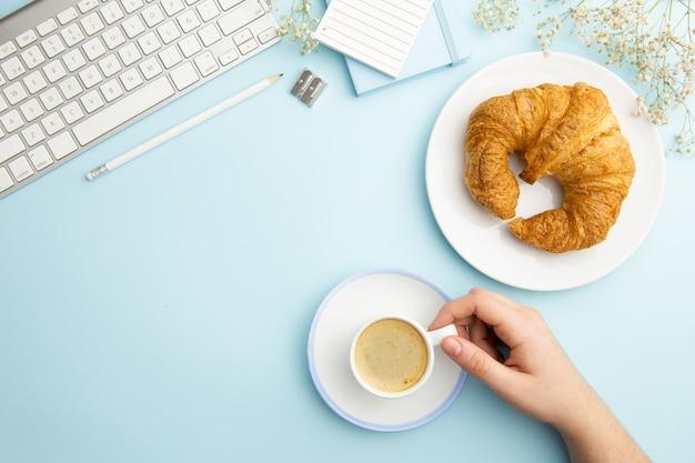 Workplace arrangement on blue background Free Photo