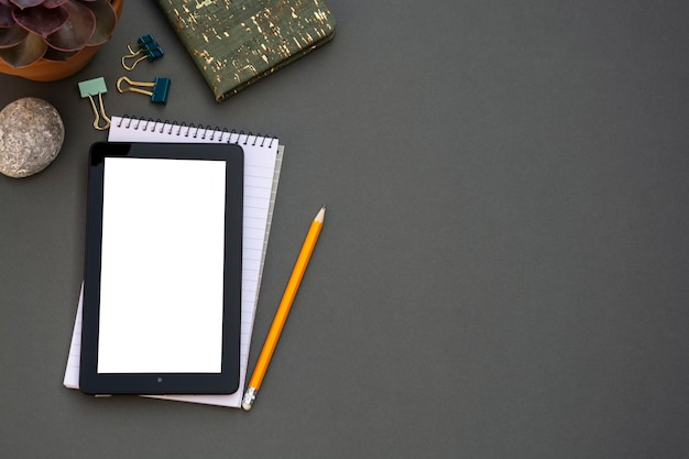 Workplace. phone, tablet and notepad on the table. Premium Photo