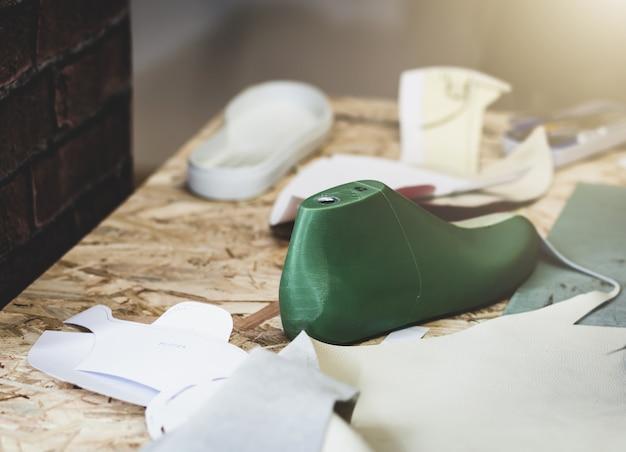 Workplace of shoe designer. Premium Photo