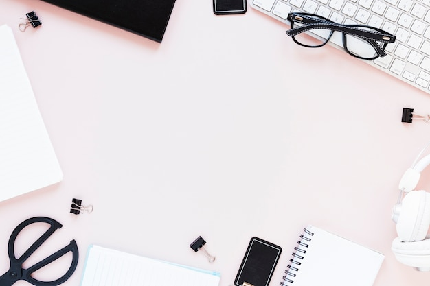 Workplace with assortment of stationery and electronic devices Free Photo