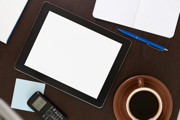 Workplace with blank digital tablet Premium Photo