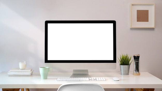 Workplace with blank screen pc comfortable work table. loft desk space Premium Photo