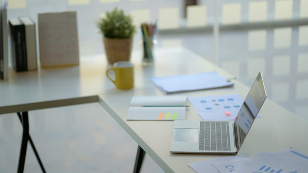 Workplace with laptop , office supplies and coffee. Premium Photo