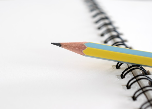 Workplace with notepad and pencil, pencil and notebook for bussiness background. Premium Photo