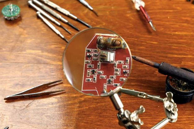 Workplace with soldering iron, microcircuit Premium Photo