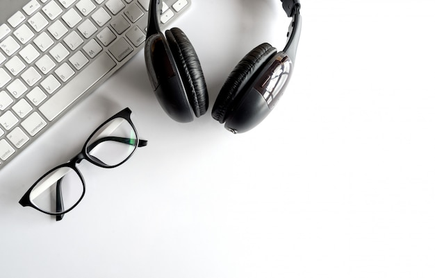 Workplace with text space, keyboard computer and headphones on white table Premium Photo