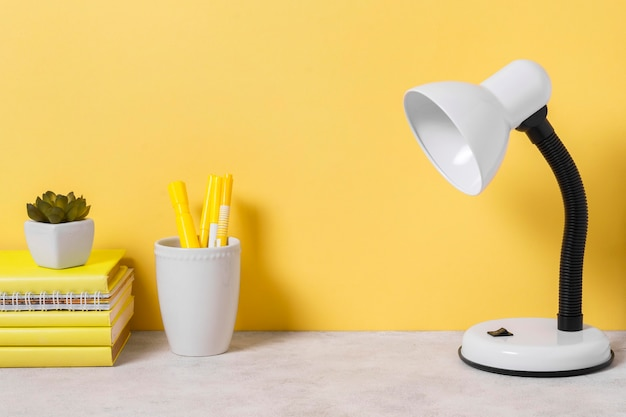 Workspace arrangement with books and lamp Premium Photo