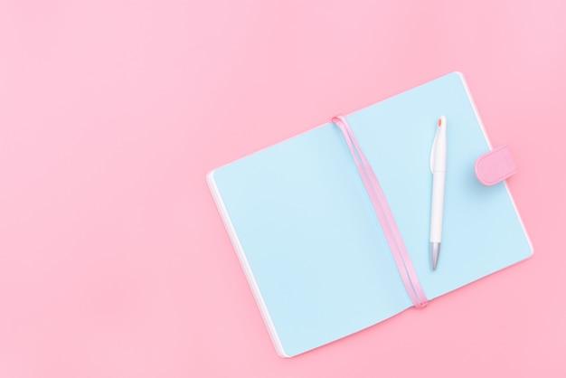 Workspace desk styled design office supplies  on pink pastel background Premium Photo