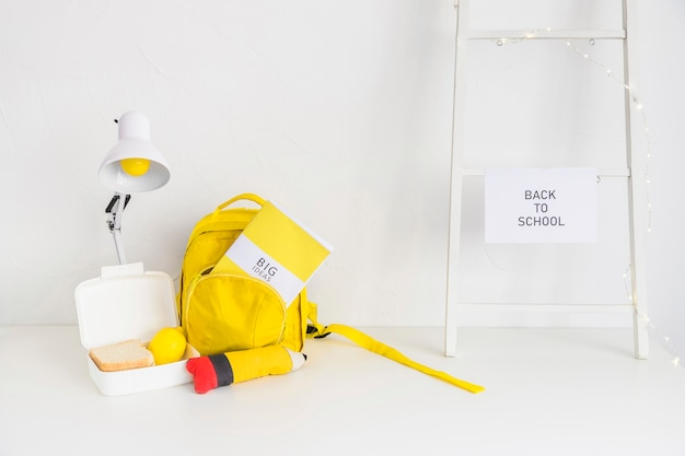 Workspace for students in white and yellow colors Free Photo
