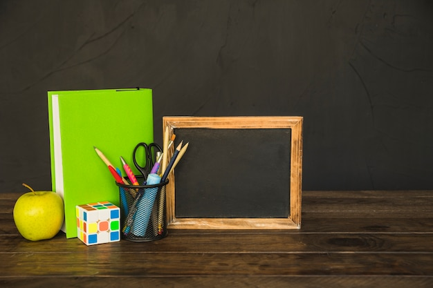 Workspace with blackboard book and stationery Free Photo