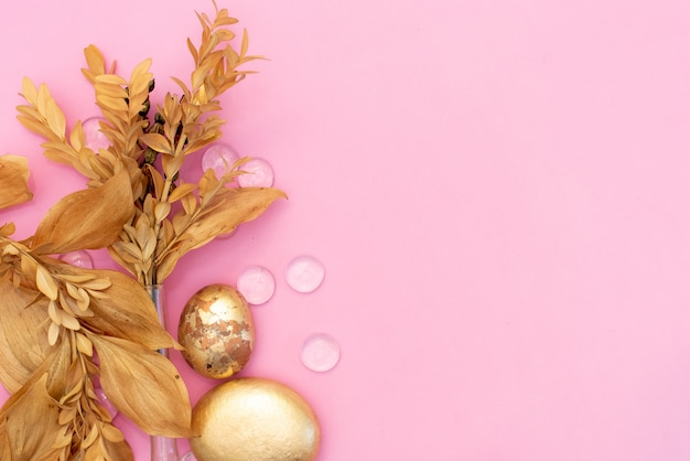 Workspace with computer, bouquet ranunculus and roses, clipboard, feminine golden fashion accessories isolated on pink background. Premium Photo