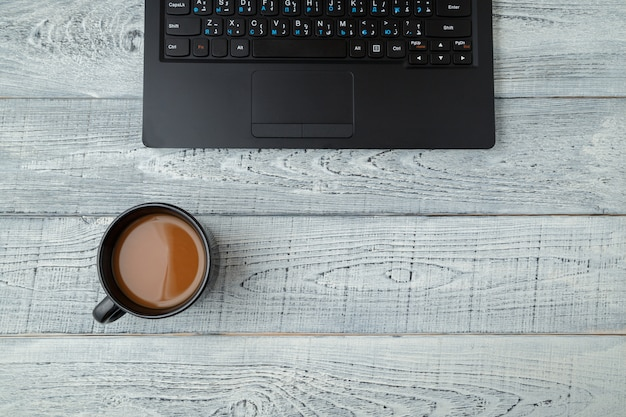 Workspace with laptop and coffee cup on wooden table Premium Photo