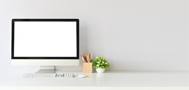 Workspace with mockup computer and office supplies with copy space office desk table. Premium Photo
