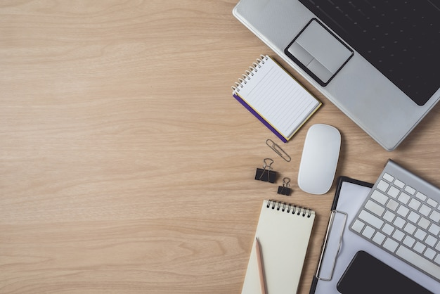 Premium Photo | Workspace with notebook and laptop on wooden background