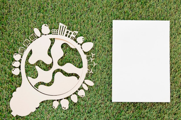World environment day wooden object with empty card on grass Free Photo