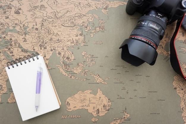 World map background with decorative camera and notebook photo world map background with decorative camera and notebook free photo gumiabroncs Images