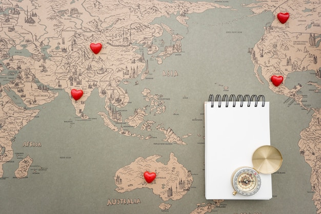 World map background with notebook and compass photo free download world map background with notebook and compass free photo gumiabroncs Choice Image