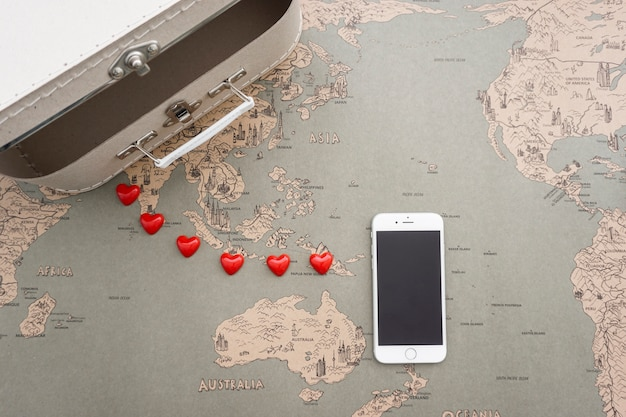 World map background with suitcase and mobile phone photo free world map background with suitcase and mobile phone free photo gumiabroncs Choice Image
