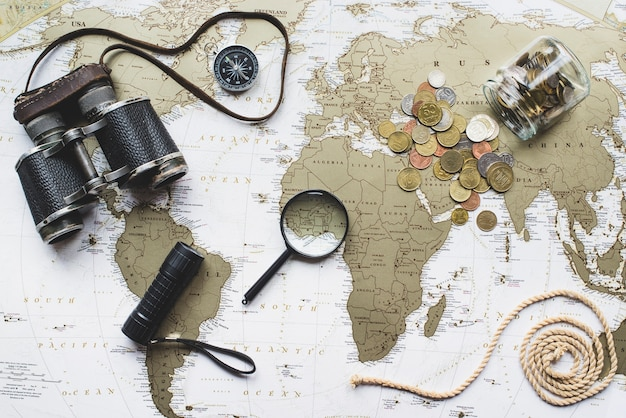 World map background with travel items Free Photo