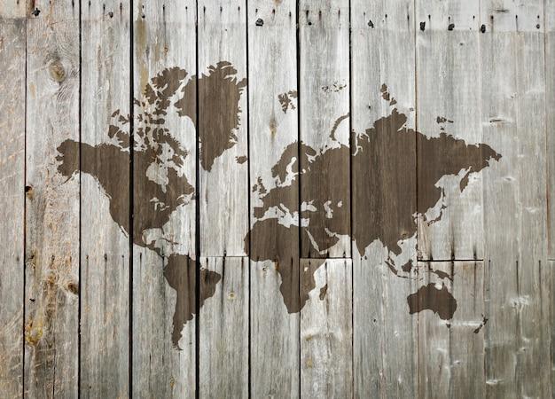 Карта мира на деревянной стене Premium Фотографии