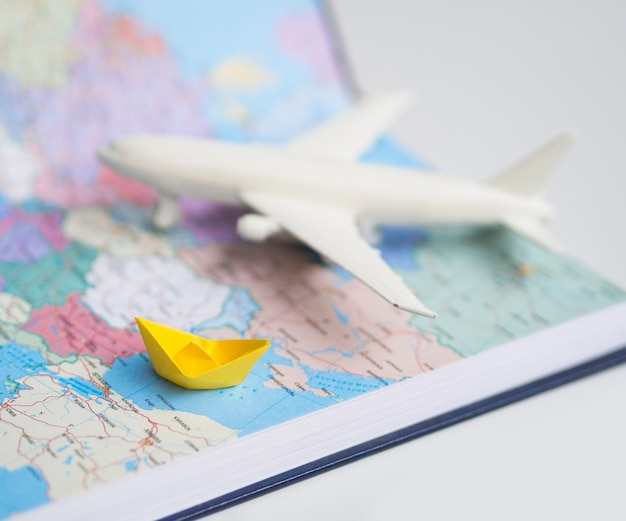 World map with blurred air plane Free Photo