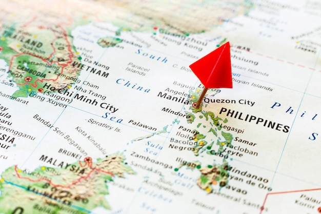 World map with pin on capital city of philippines Premium Photo
