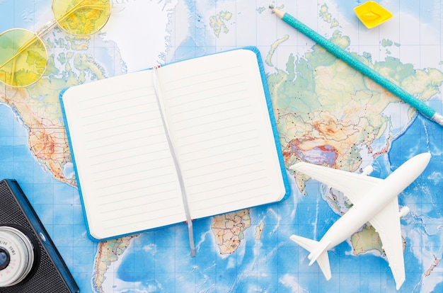 World map with travelling notebook Free Photo