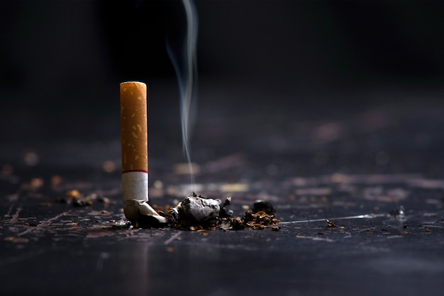 World no tobacco day concept stop smoking.tobacco cigarette butt on the floor Premium Photo