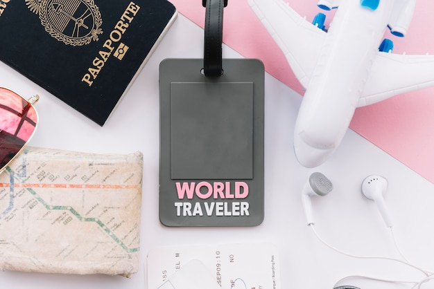 World traveler tag with passport; map; toy airplane; earphone on white background Free Photo