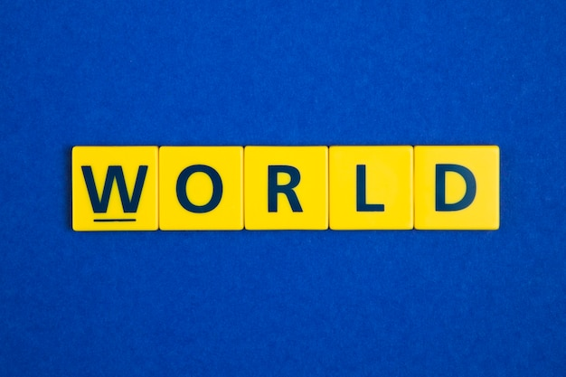 World word on yellow tiles Free Photo