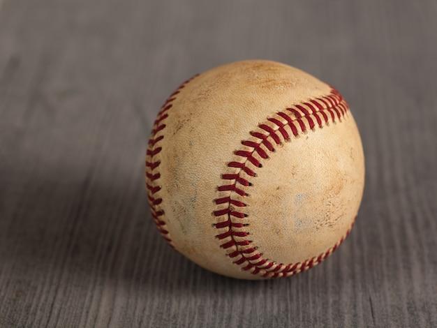 Worn baseball on the wooden table Premium Photo