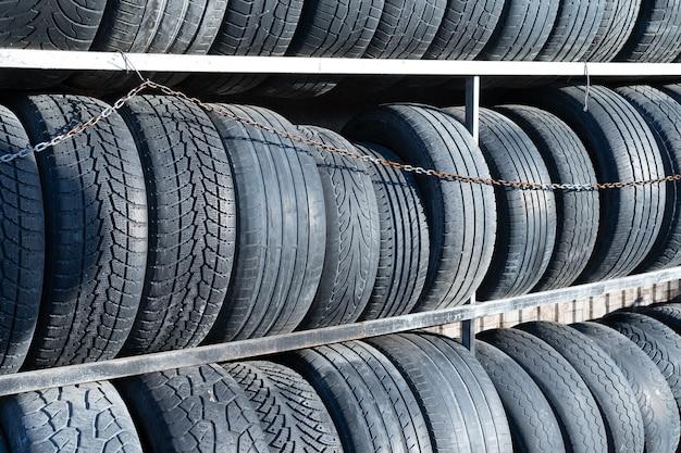 Worn out car tires on shelves Premium Photo