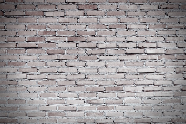 Worn red brown brick wall. the facade of an industrial building. Premium Photo