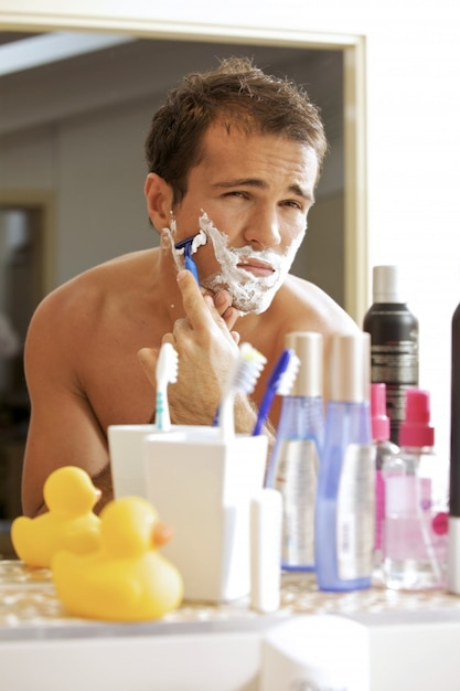 worried man bathroom shaving toothbrush Free Photo