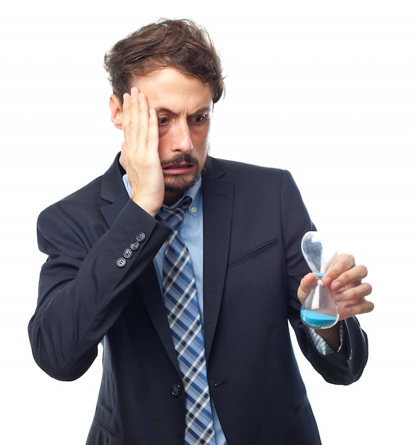 Worried man looking at an hourglass Free Photo
