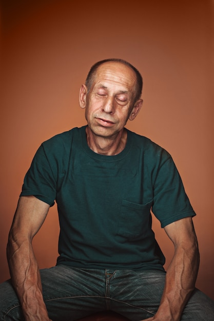 Worried mature man sitting and thinking about something Free Photo