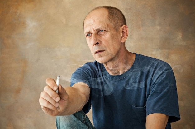Worried mature man sitting Free Photo